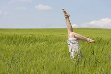 Free Legs Raised Up From Green Grass Royalty Free Stock Images - 14424699