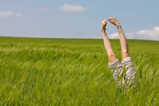 Free Legs Raised Up From Green Grass Royalty Free Stock Photography - 14424717