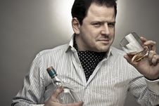 Handsome Man With A Glass Of Cognac Royalty Free Stock Image