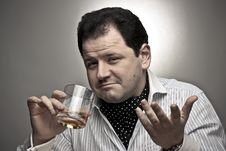 Handsome Man With A Glass Of Cognac. Royalty Free Stock Photos
