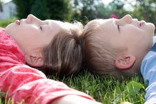 Free Boy And Girl Laying On Grass Stock Photos - 14426003
