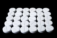 Free White Pills Arranged On The Black Stock Photography - 14426612