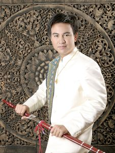 Free Thai Man In Silk Dress Royalty Free Stock Photos - 14428628