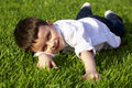 Free Boy Lying On Grass Royalty Free Stock Photography - 14431187