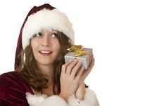 Woman In Santa Claus Costume Holds Christmas Gift Royalty Free Stock Photo