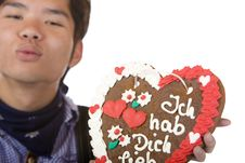 Free Man Holds Gingerbread Heart And Give Kiss Royalty Free Stock Photography - 14430817