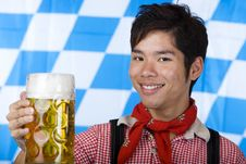 Free Smiling Asian Holds Oktoberfest Beer Stein (Mass) Stock Images - 14430824