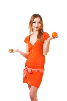 Young Pretty Girl In Dress With Orange And Kiwi Royalty Free Stock Photos