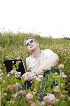 Free Man With Laptop On Meadow Stock Photo - 14431940