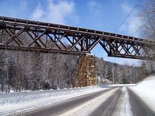 Free Train Trestle Bridge Over A Snowy Road Stock Photography - 14433352