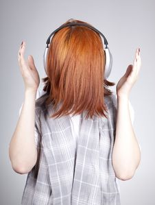 Unusual Red-haired Girl With Headphones Royalty Free Stock Image
