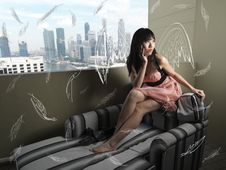 Surreal Girl With Abstract Wings Sitting Stock Image