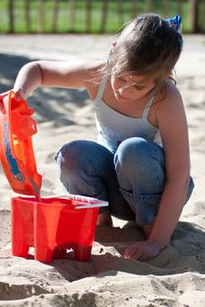 Free Girl Playing In A Sand Pit Royalty Free Stock Photography - 14437037