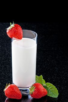Milk Glass With Strawberries Stock Photography