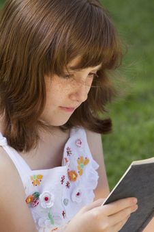Free Young Beautiful Girl Reading A Book Stock Images - 14437744