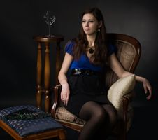 Free Portrait Of Woman Seated In A Chair Stock Photo - 14438770