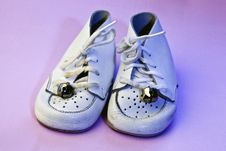 Vintage Baby Shoes On Pink Royalty Free Stock Images