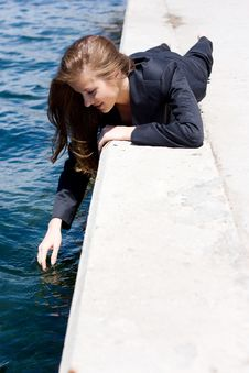 Free Woman Near The Water Royalty Free Stock Image - 14448556