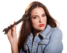 Woman And Wrench Royalty Free Stock Photography