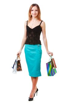 Free Attractive Young Lady In Blue Skirt With Packets Stock Images - 14448674