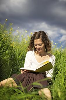 Free Woman Reading In High Grass Stock Images - 14448914