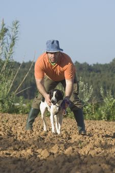 Farmer Walking With Is Dog Stock Image