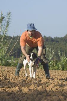 Farmer Walking With Is Dog