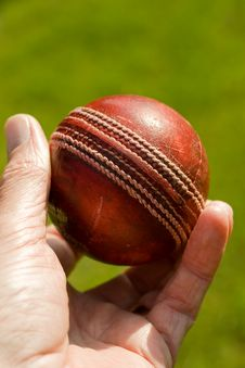 Used Red Leather Cricket Ball Stock Photo