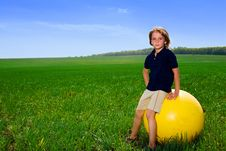 Free Boy With Ball In Field Stock Image - 14451151