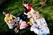 Children With Toys On Grass Stock Photography