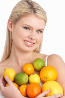 Free Young Woman Holding Citrus Fruit In Studio Royalty Free Stock Image - 14451726