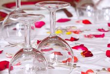 Glasses On A Table A White Tablecloth Royalty Free Stock Photos