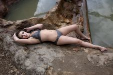 Free Woman In Bikini Laying On Back On Rocks Stock Images - 14452844