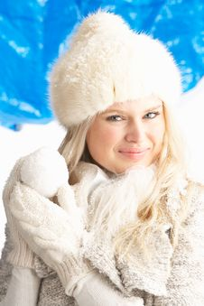 Young Woman Wearing Winter Clothes In Studio Royalty Free Stock Image