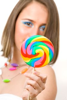 Pretty Young Woman With Colorful Lollipop Royalty Free Stock Images