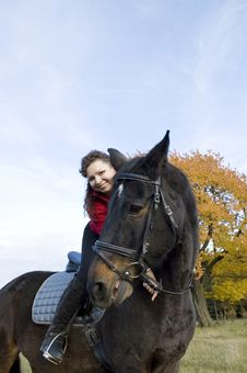 Two Smiles. Equestrienne And Horse. Royalty Free Stock Photo