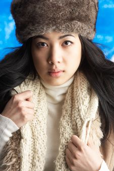 Young Woman Wearing Winter Clothes In Studio Royalty Free Stock Images