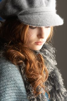 Free Teenage Girl Wearing Cap And Knitwear In Studio Stock Images - 14455104