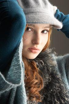 Free Teenage Girl Wearing Cap And Knitwear In Studio Stock Photos - 14455383