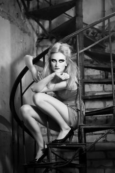 Fashion Model Posing On The Spiral Stairs Stock Image