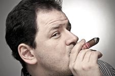 Free Handsome Man Smoking A Cigar. Stock Images - 14455624