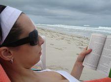 Free Reading On The Beach Royalty Free Stock Photo - 14455695
