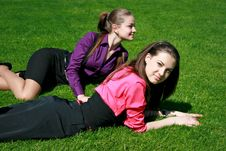 Free Young Businesswomen Relaxing On The Grass Stock Images - 14456104