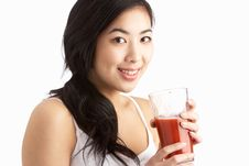 Free Young Woman Enjoying Healthy Drink In Studio Stock Image - 14456211