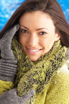 Young Woman Wearing Winter Clothes In Studio Stock Image