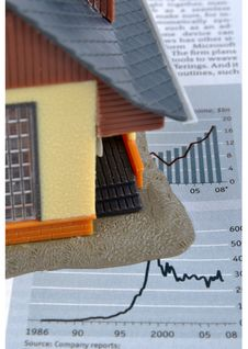 House Model And Economy Information Stock Photo