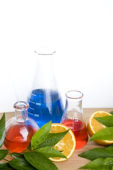 Free Laboratory Flask And Orange Royalty Free Stock Images - 14457979