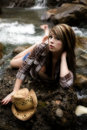 Free Cowgirl By River On Stomach Stock Images - 14468584