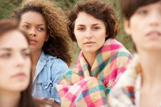 Group Of Girls Sitting On Beach Together Stock Photography