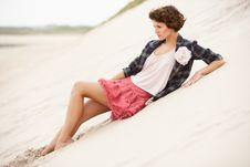Attractive Young Woman Standing Amongst Sandunes Stock Photo